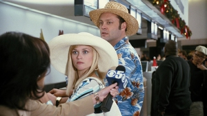 "(L-r) The holiday escape plans of Kate (REESE WITHERSPOON) and Brad (VINCE VAUGHN) are thwarted when they are cornered by a reporter at the airport in New Line CinemaÕs romantic comedy, ÒFour Christmases,Ó distributed by Warner Bros. Pictures. ""PHOTOGRAPHS TO BE USED SOLELY FOR ADVERTISING, PROMOTION, PUBLICITY OR REVIEWS OF THIS SPECIFIC MOTION PICTURE AND TO REMAIN THE PROPERTY OF THE STUDIO. NOT FOR SALE OR REDISTRIBUTION."""